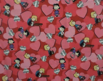 Valentine Peanuts Charlie Brown and gang with a piano and music notes and red and pink hearts this fabric is  sold by the yard.