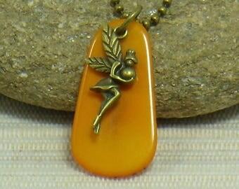 Orange fairy on a petal