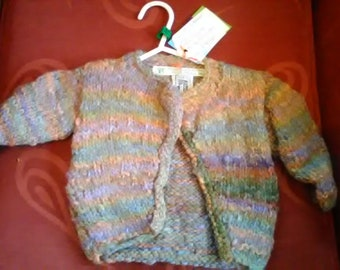 Hand knitted cardigan, knitted in home spun wool to fit a baby girl aged 6-9 months old
