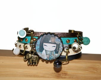Child doll Japanese gold, blue-green cuff and anthracite gray