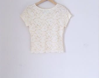 Vintage nylon lace cropped top. 90s 80s Cream lace top with some stretch. Fully lined. Made in USA.
