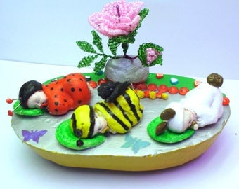 Bee, ladybug, and baby rabbit sleeping under a Rosebush corn dough