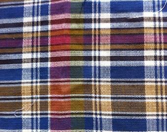 fabric has purple and purple Plaid