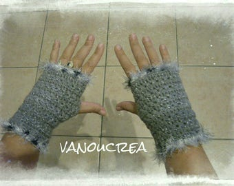 a pair of metallic grey mitten