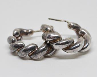 Silver tone metal earrings