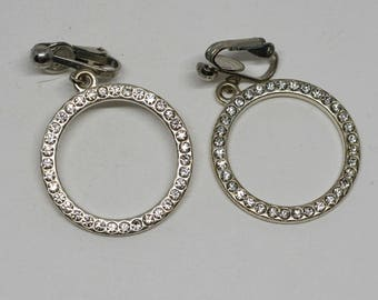 charming round silver tone earrings