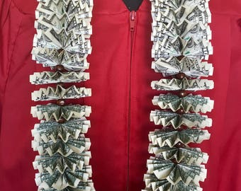 Money lei with 50 dollar bills for graduation made with 50 one dollar bills