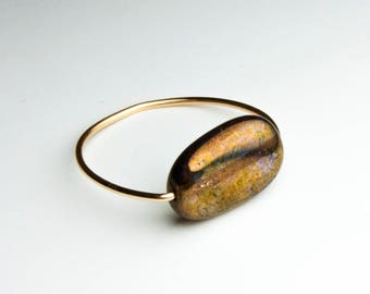 Skinny ring with transparent golden brown Czech glass bead