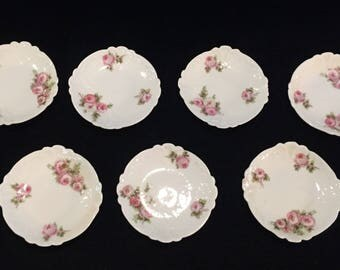 Seven Antique Haviland Limoges Butter Pats