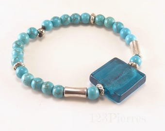 Bracelet in turquoises (gemstones) and turquoise square Murano with inclusion of a silver leaf