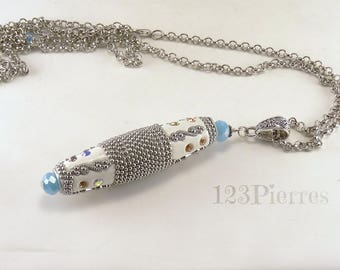 Indonesian ethnic pendant with spectacular white bead, jade blue crystal, mounted on a long  silvery chain