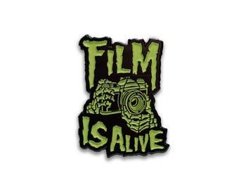 Film is Alive Glow in the Dark Lapel Pin