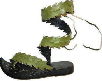 Black leather sandals with leaves