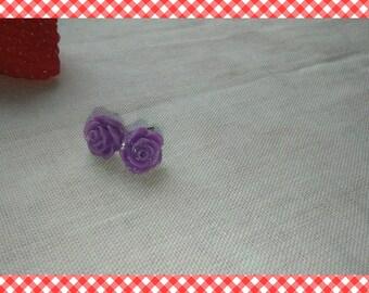 A pair of earrings purple pink glitter resin