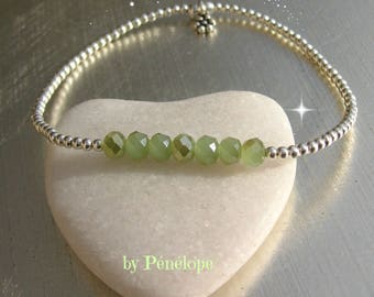 Silver bracelet in925th and faceted opaque green glass beads