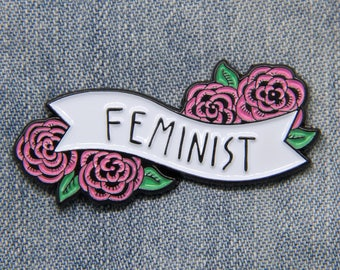 Feminist enamel pin of a black and white banner with pink flowers - Cute empowering feminism quote pin for women - Cool Valentines gift pins