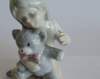 Vintage chine porcelain figure, girl with Kahu