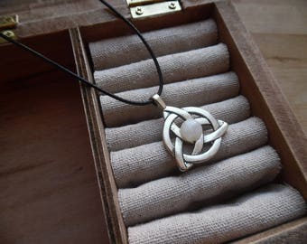 Celtic, Triquetra pendant adorned with a white labradorite