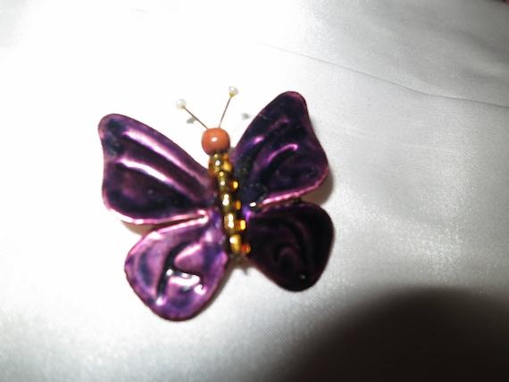 Lovely butterfly brooch has purple glaze over copper