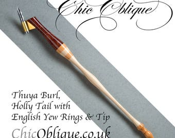 Oblique pen holder, Thuya Burl Body with American Holly tail with English Yew tip and rings