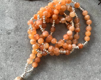 Mala decorated final Pearl of petrified coral from carnelian (natural), with silver,