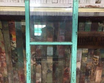 Turquoise wooden storm window