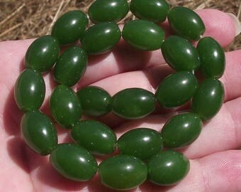 2 LARGE PEARLS NATURAL OVAL EMERALD. 14X10MM *.