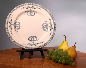 Beautiful and antique white plate with ribbons and wreaths, french ironstone from Salins les Bains. Service Montholon. French Transferware