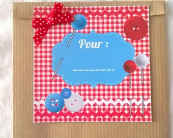 Kraft sewing theme gift bag and its red and blue label