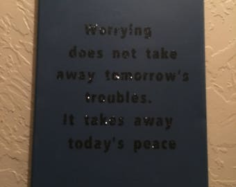 Deep blue Canvas wall art with sparkly black saying on it