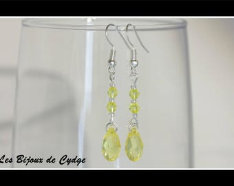 Earrings and its drop yellow with its tops