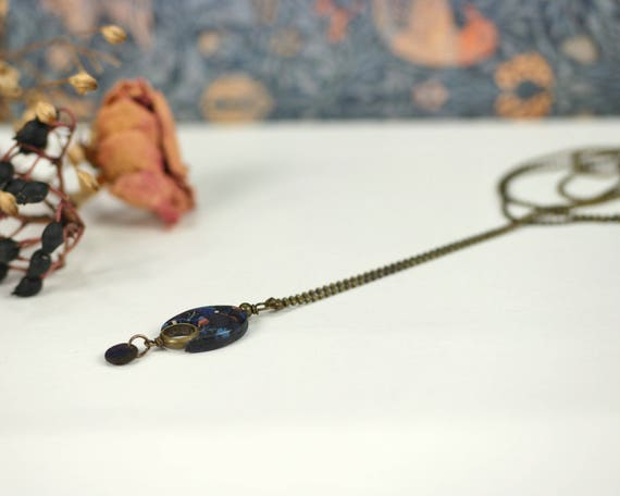 Long necklace with a black and dark blue, oval, handmade pendant 'Nelumbo', vegetal patterns, brass necklace, minimal design