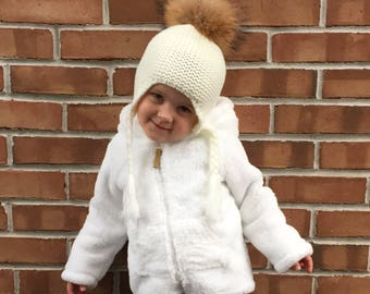 Hand knitted cream hat with real fur pompom