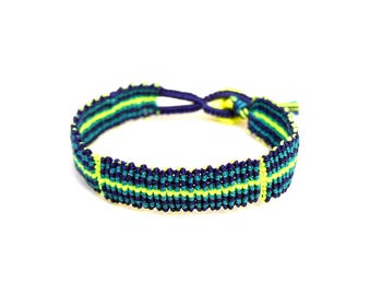 Peer's hand knotted bracelet: navy, teal and neon yellow c lon bead cord and a button clasp