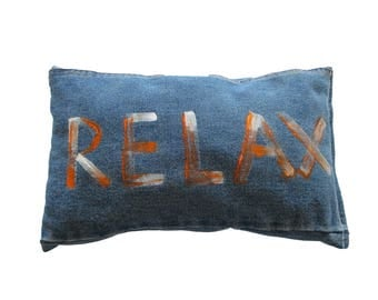 Tell the with a painted jeans cushion