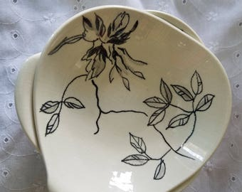 2 small red wing pottery bowls. White with painted black leaves and a flower.