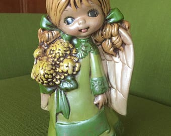 Vintage 70s Retro Christmas Ceramic Angel Blonde Big Eye Girl in a Green Dress Figurine/Statue Holding Bouquet of Yellow Flowers with Wings