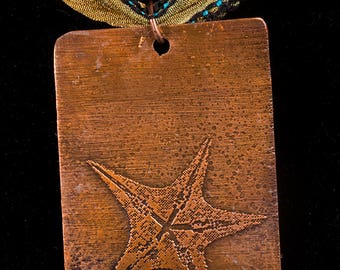 Heat treated copper pendant with etched starfish design
