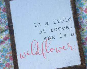 In a field of roses, she is a wildflower.