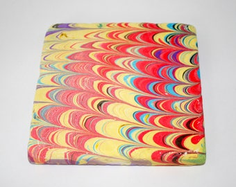 Hand marbled tile with nonpareil design.(025)