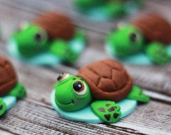 A set of 12 Edible Sea Turtle cupcake toppers