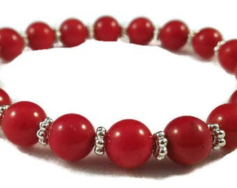 Bracelet with coral beads 8 mm and ob flat Tibetan silver