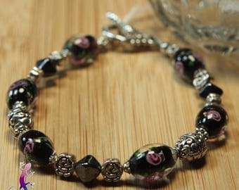 Bracelet with toggle clasp black and pink lampwork beads