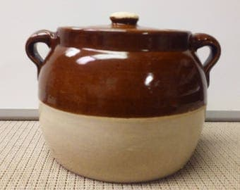 Ceramic brown and cream colored bean pot made in mid-1900s