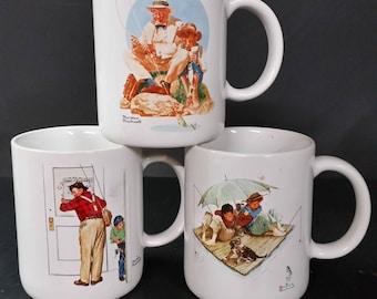 Norman Rockwell mugs. Buyer's choice.