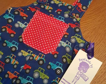 Age 2 reversible dungarees romper. Tractors and red and white polka dot.