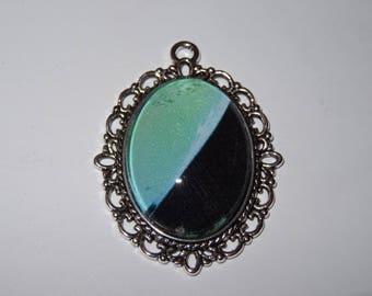 Antique bronze metal graphic pendant blue green and black