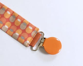 Orange baby pacifier