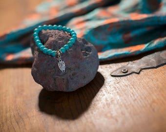 Turquoise stone bracelet with wise owl