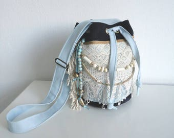 FREE SHIPPING!! Bucket bag cross body bag of ice blue stretch cotton and dark blue leather. With lace, gold-coloured accessories and fringes.